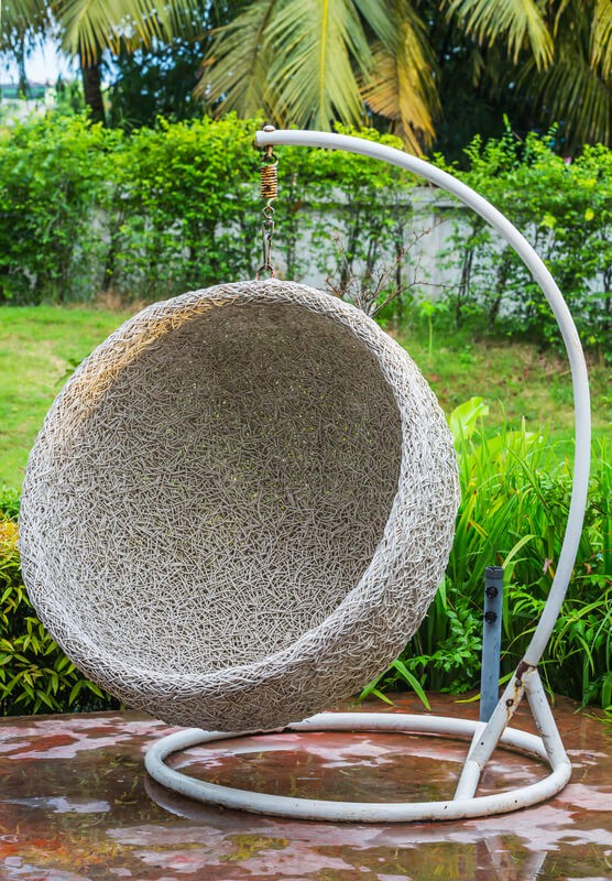 Hanging rattan chair for outdoor use.