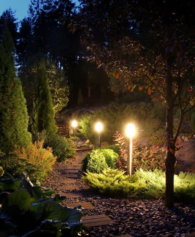 Illuminated home garden path patio lights in evening dusk.