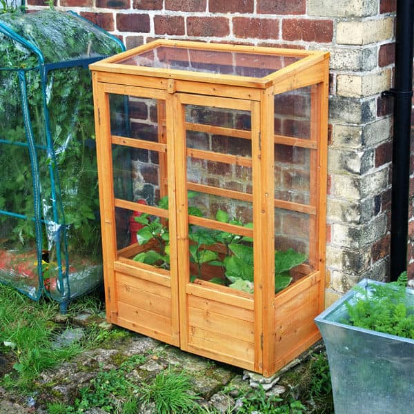 Planter boxes on pinterest mini greenhouse greenhouses Small green home plans