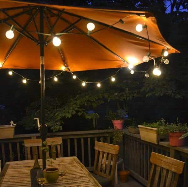 One excellent and unexpected way to provide functional backyard lighting to an outdoor dining area is with umbrella lights. Umbrella lights attach to your patio umbrella to provide light to the table underneath.
