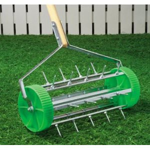 Revitalizing Soil With A Rolling Lawn Aerator