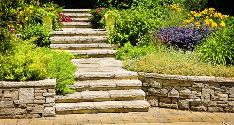 Natural stone landscaping in home garden with stairs.