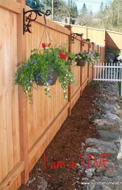 20 beautiful fence designs and ideas page 7 of 20 yard for Fence hanging flower pots