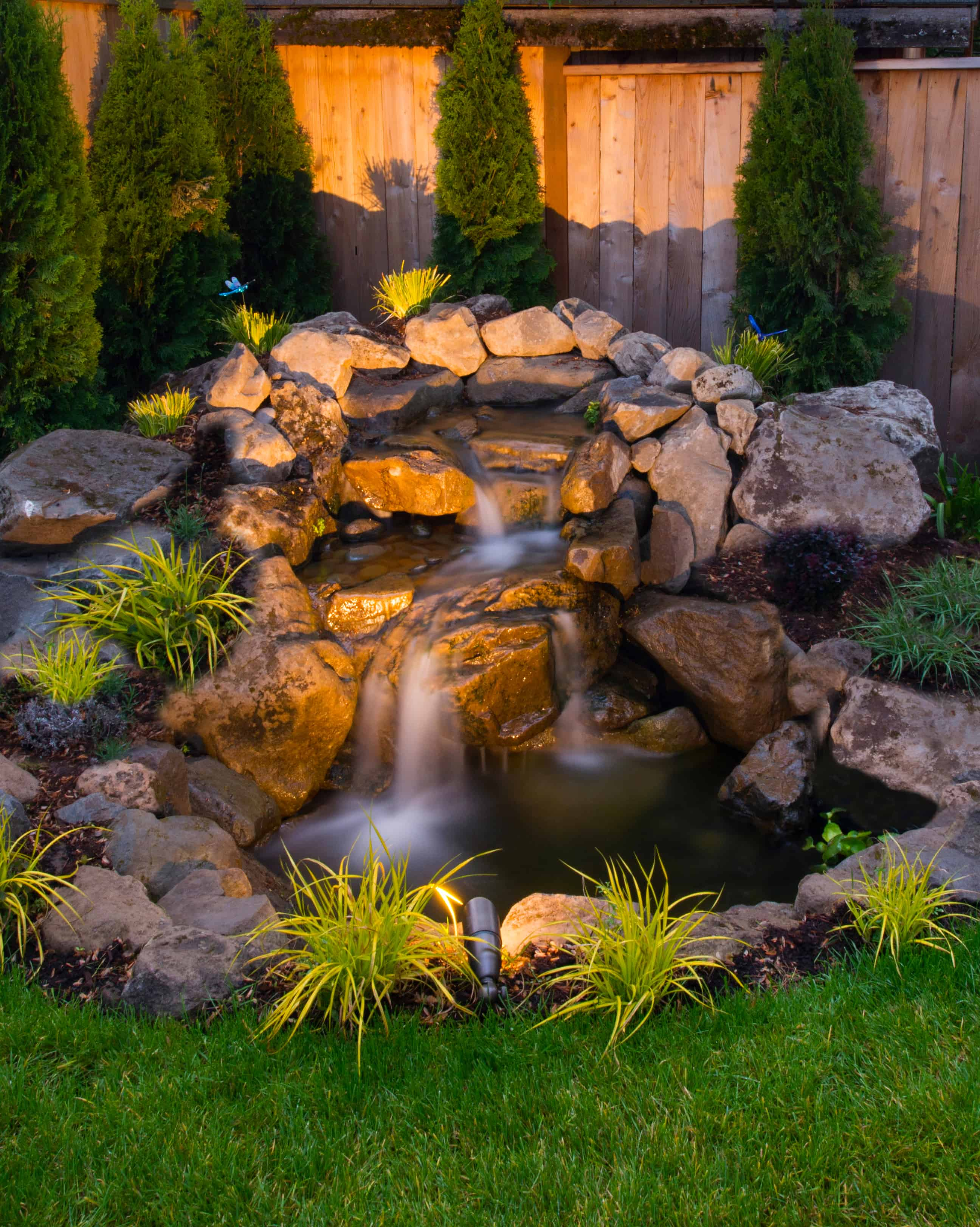 Check out this amazing backyard pond idea.