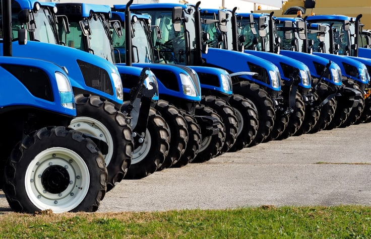 close up of brand new blue tractors