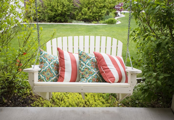hanging bench with pillows
