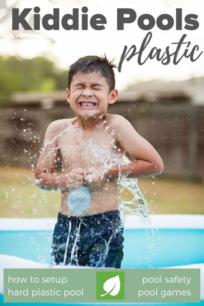 young boy kid getting splashed swimming pool