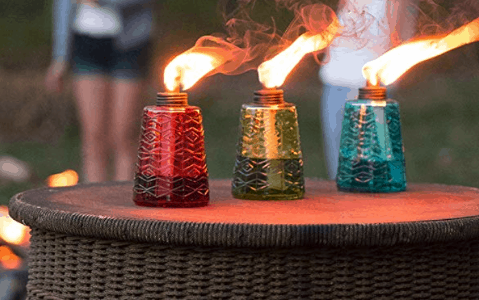 Table Top Tiki Torches sitting on a table like candles