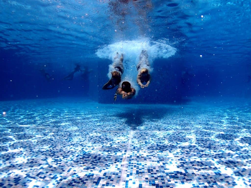 diving into underwater swimming pool