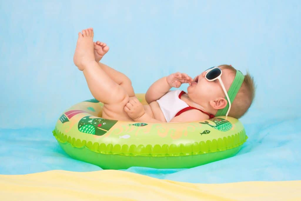 baby lounging pool