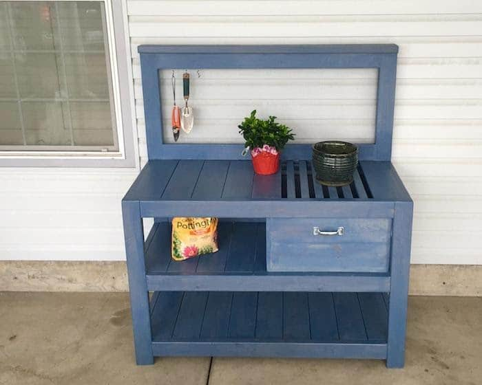 Blue Potting Bench with Built-In Soil Storage